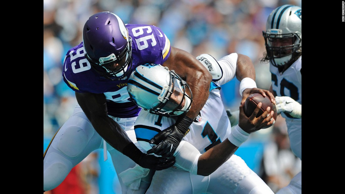 Carolina quarterback Cam Newton is sacked in the end zone by Minnesota's Danielle Hunter during an NFL game in Charlotte, North Carolina, on Sunday, September 25. The Vikings sacked Newton eight times en route to a 22-10 victory.