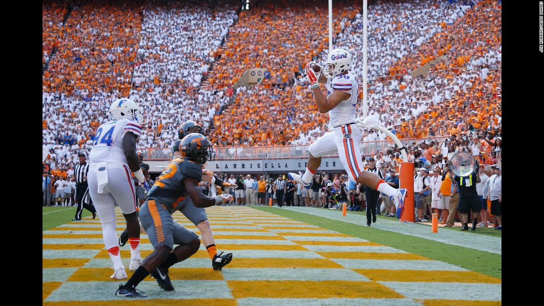 Florida's DeAndre Goolsby catches a touchdown pass to open the scoring in Knoxville, Tennessee, on Saturday, September 24. Tennessee fell behind 21-0 before rallying to win 38-28, ending an 11-game losing streak to its SEC East rival.
