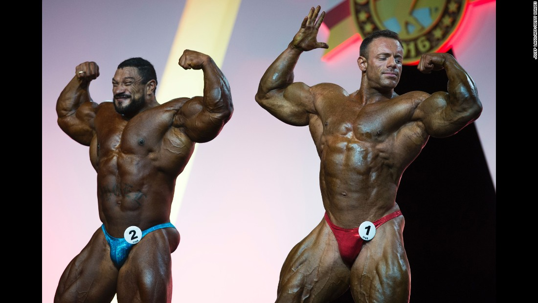 Bodybuilders pose for the judges during the Arnold Classic Europe event on Saturday, September 24.