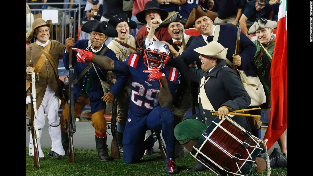 "LeGarrette Blount, a running back for the New England Patriots, celebrates with the ""End Zone Militia"" after scoring a touchdown against Houston on Thursday, September 22. Blount had two touchdowns in the game, which the Patriots won 27-0."