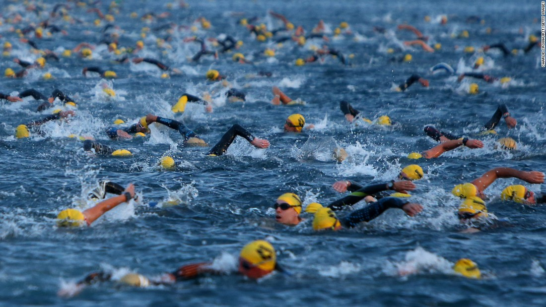 Triathletes swim during the Ironman race in Palma de Mallorca, Spain, on Saturday, September 24.