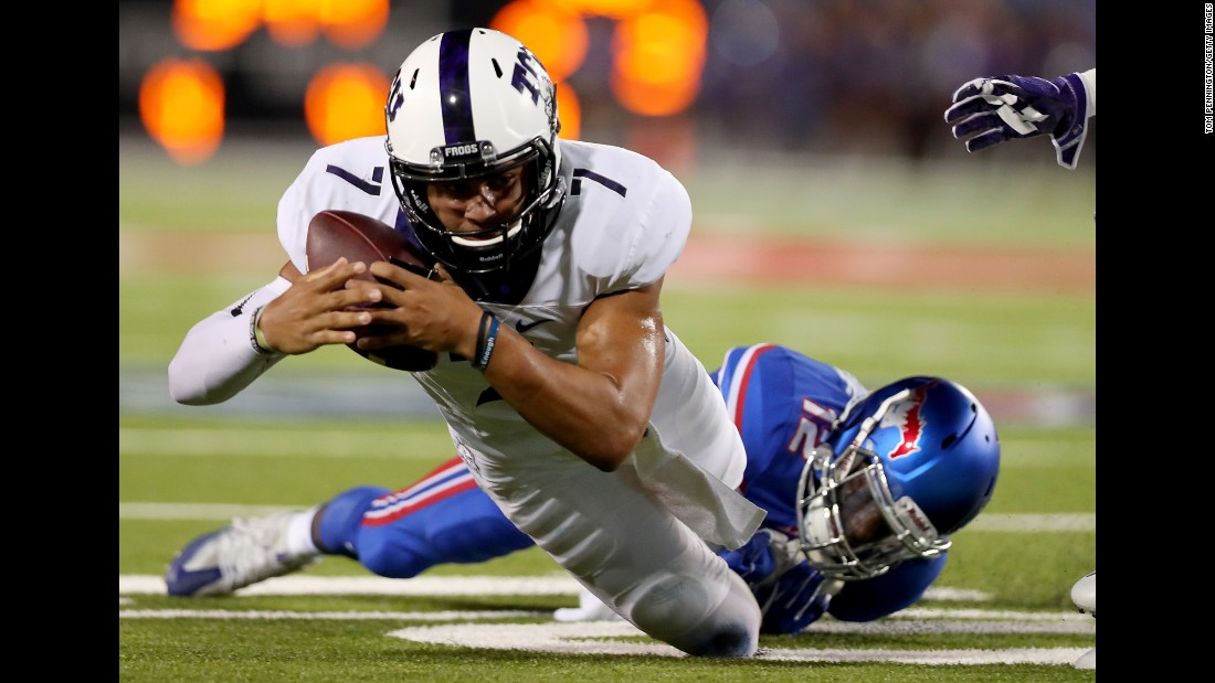 TCU quarterback Kenny Hill carries the ball against SMU during a college football game in Dallas on Friday, September 23. Hill threw for 452 yards as TCU won 33-3.