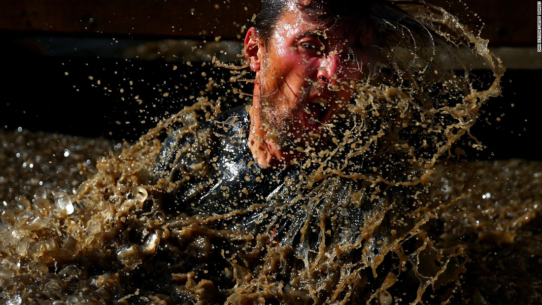 A participant splashes in water during a Tough Mudder race in Horsham, England, on Saturday, September 24.