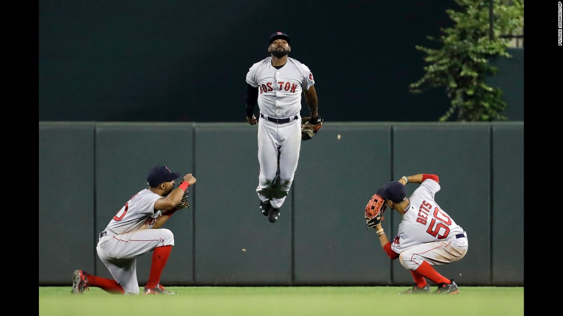 From left, Boston outfielders Chris Young, Jackie Bradley Jr. and Mookie Betts celebrate a win in Baltimore on Tuesday, September 20.