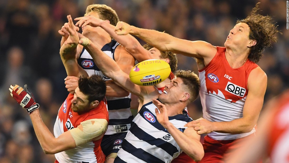 The Geelong Cats and the Sydney Swans compete for a ball during an Australian Football League match in Melbourne on Friday, September 23.