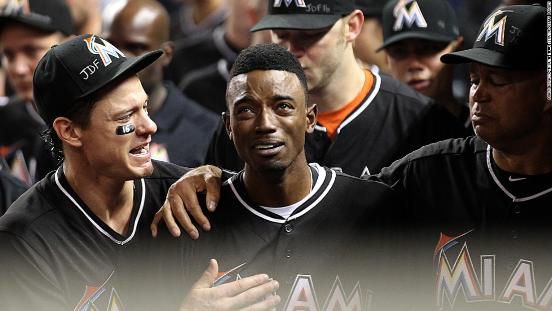 "Miami Marlins second baseman Dee Gordon is consoled by teammates after hitting a leadoff home run against the New York Mets on Monday, September 26. Gordon and the rest of the Marlins were mourning teammate Jose Fernandez, <a href=""http://www.cnn.com/2016/09/25/us/mlb-pitcher-jose-fernandez-dead/"" target=""_blank"">who died in a boating accident</a> Sunday at the age of 24. All the Marlins wore Fernandez jerseys during their game on Monday."