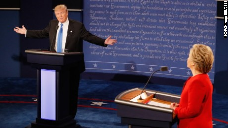 Republican presidential nominee Donald Trump (L) speaks as Democratic presidential nominee Hillary Clinton (R) listens during the Presidential Debate at Hofstra University on September 26, 2016 in Hempstead, New York.  The first of four debates for the 2016 Election, three Presidential and one Vice Presidential, is moderated by NBC's Lester Holt.
