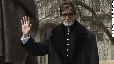 Amitabh Bachchan  beside a statue of Mahatma Gandhi in Parliament Square in London.