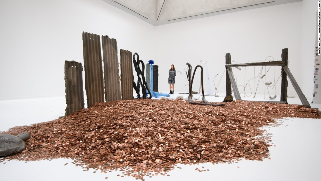 """Dean starts his process with writing, which he then gives physical form...using materials that are instantly recognisable from everyday life such as concrete, soil, sand, and corrugated sheet metal,"" says the museum."