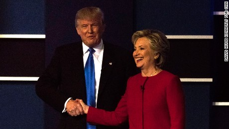 Donald Trump and Hillary Clinton shake hands at the first presidential debate on September 26, 2016, in Hempstead, New York.