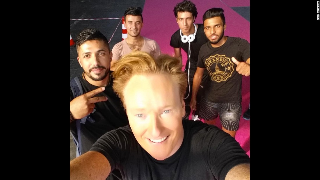 """Just made friends with refugees at #Tempelhof Airport in #Berlin,"" <a href=""https://www.instagram.com/p/BKGxhI0D5fZ/"" target=""_blank"">talk-show host Conan O'Brien said on Instagram</a> on Thursday, September 8. ""Gentleman, we have our album cover."""