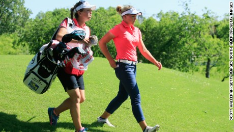 Sister act: Brittany (left) caddies for Brooke.