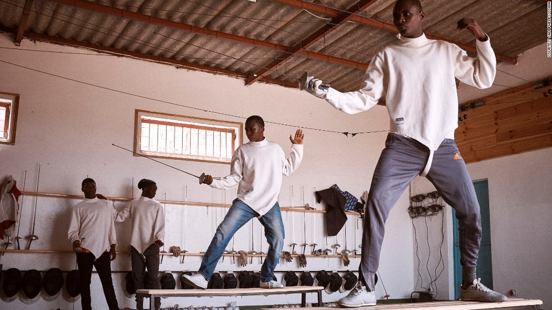 "But Robin insists ""It's about building relationships of trust, in a neutral space, between jailed minors and adults, from whom they have often felt a sense of betrayal.""  For example, 17-year-old Daouda says, ""[fencing] teaches you to have an open heart. When you have won you must go up to your opponent and you give your hand and shake."" He adds, ""The competitors respect you.""<br />"