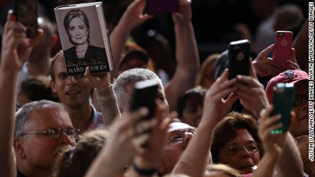 TAMPA, FL - JULY 22: Supporters take pictures with their cell phones of democratic presidential candidate former Secretary of State Hillary Clinton during a campaign rally on July 22, 2016 in Tampa, Florida. With three days to go until the Democratic National Convention, Hillary Clinton is campaigning in Florida. (Photo by Justin Sullivan/Getty Images)
