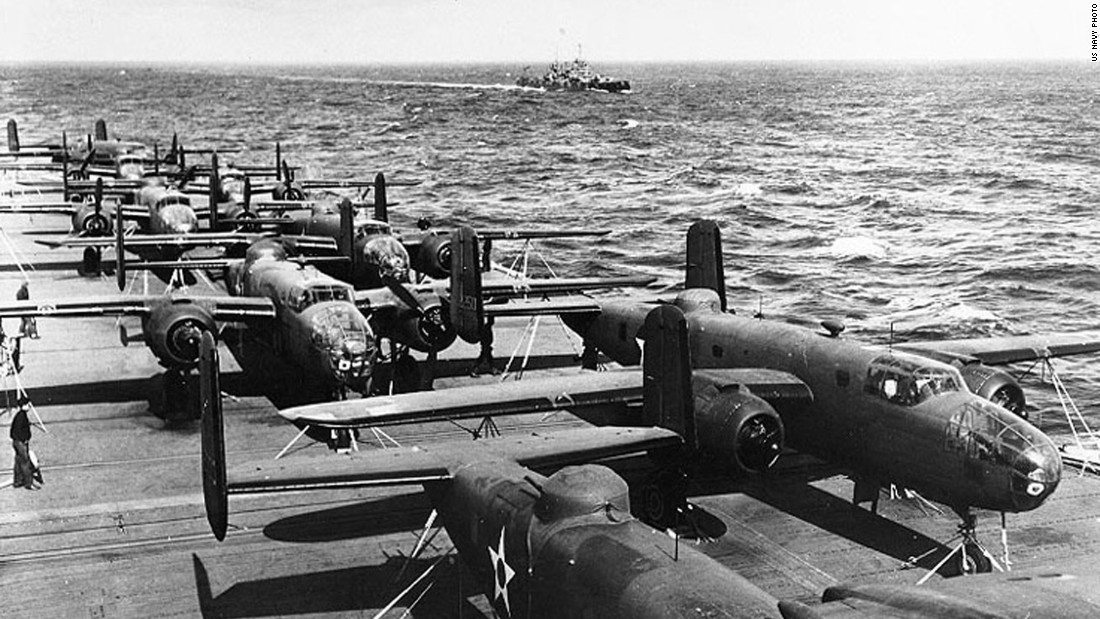 "As revenge for Japan's attack on Pearl Harbor, 80 US pilots, gunners, navigators and bombardiers led by Lt. Col. James ""Jimmy"" Doolittle performed a daring one-way mission to bomb Japan in 1942. Half of the mission's 16 North American B-25 Mitchell bombers are seen here parked on the flight deck of the USS Hornet. Click through the gallery to see more images of the raid."