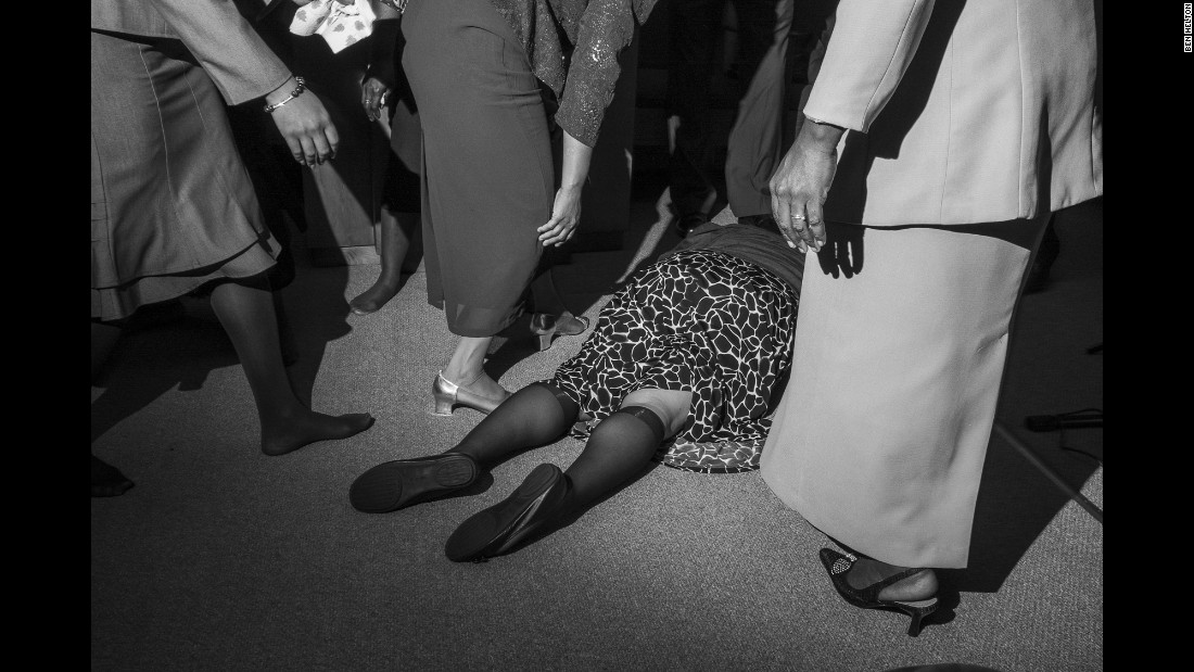 A church member collapsed to the floor during a praise break, Helton said. She was helped up.