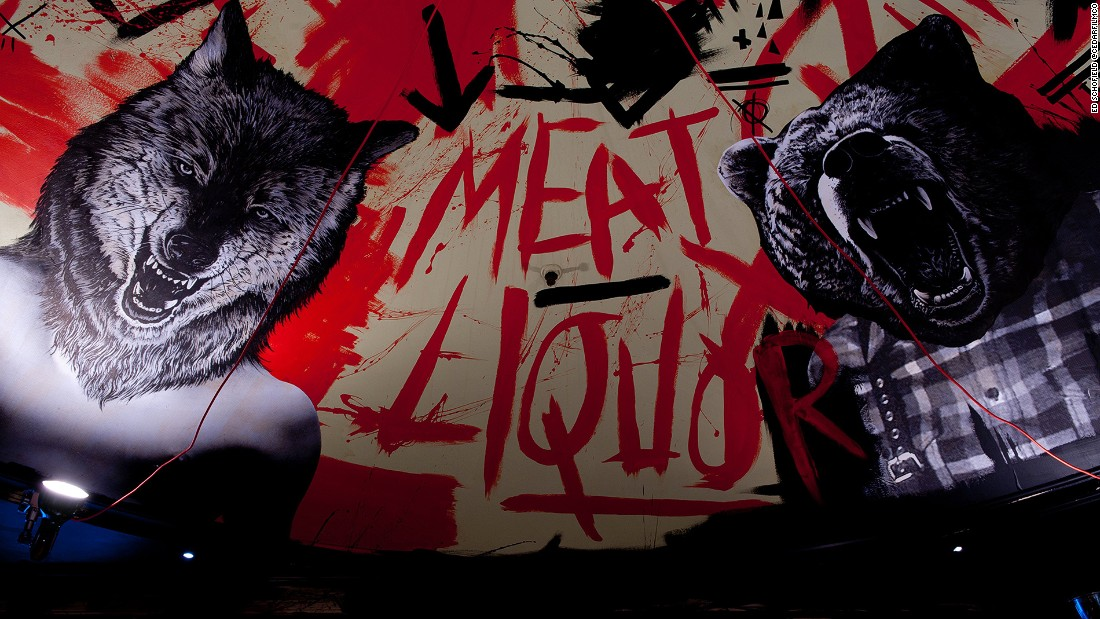 "With occult-inspired and ""bloody"" interiors, MEATliquor serves US-style heavy, meaty meals with loud, heavy metal music.<br />"