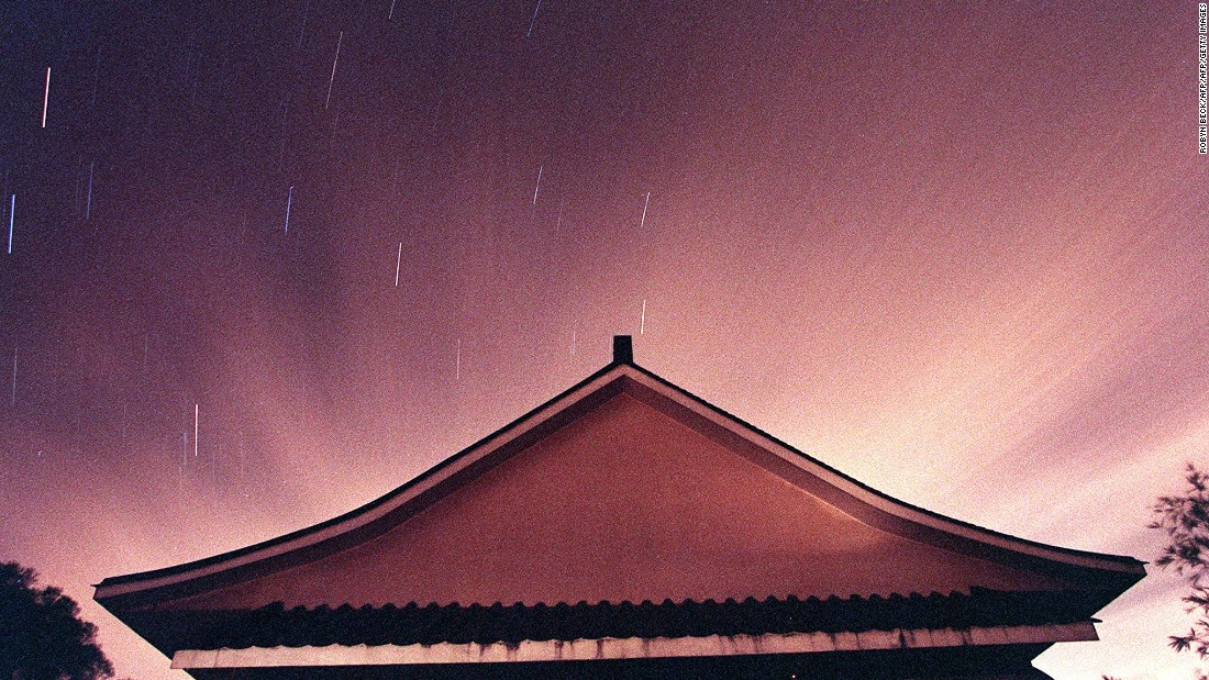 Stars streak above a building on Tai Mo Shan, Hong Kong's tallest mountain, during a Leonid meteor shower.