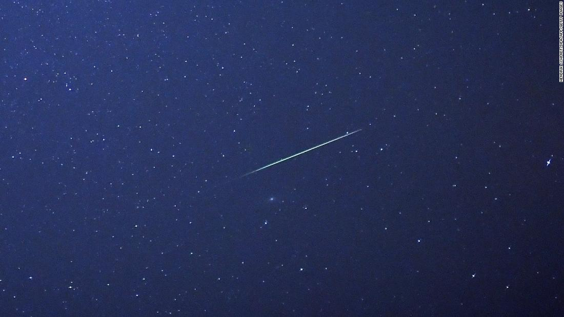 A shooting star crosses the sky over eastern Germany, during the peak in activity of the annual Perseids meteor shower on August 13, 2015.