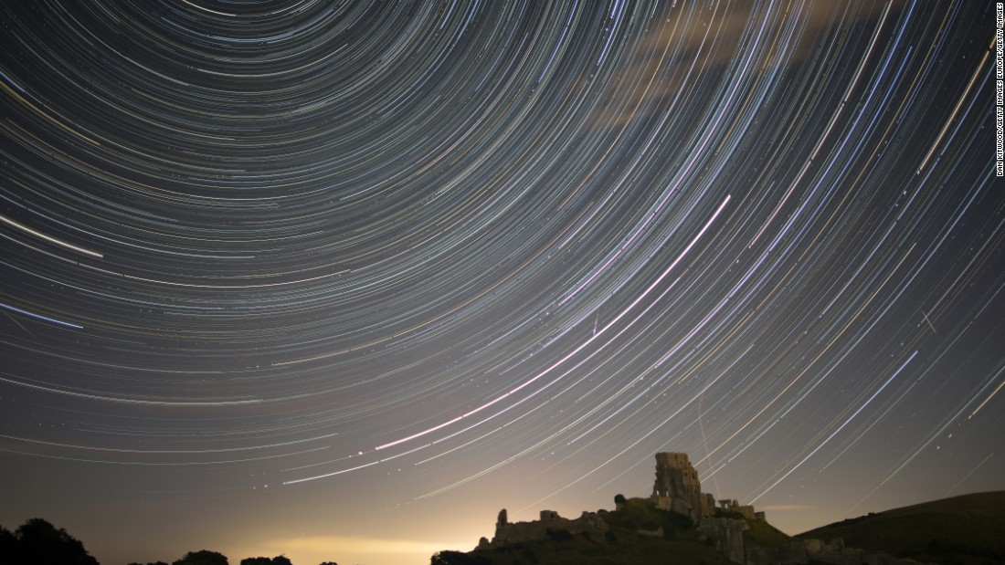 Satellites, planes and comets cross the night sky above Corfe Castle, in the United Kingdom, on August 12, 2016.