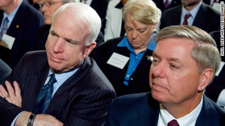 Arizona Republican Senator John McCain (C) listens alongside Connecticut Democrat Senator Joe Lieberman (L) and South Carolina Republican Senator Lindsey Graham (R) during the opening of the Fiscal Responsibility Summit hosted by US President Barack Obama in the East Room of the White House in Washington, DC, February 23, 2009.