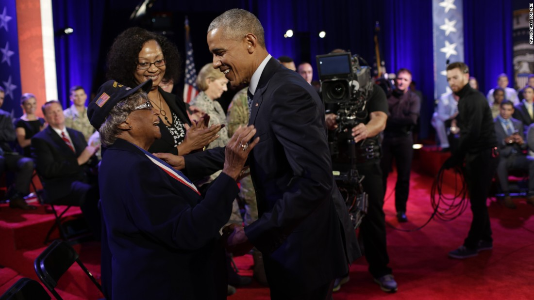 Obama greets World War II veteran Millie Veasey after the event.