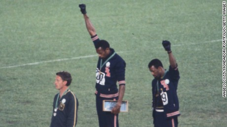 American sprinters Tommie Smith and John Carlos bow their heads and raise gloved fists in protest at the 1968 Olympics in Mexico City.