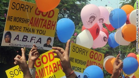 Fans wait outside the Bollywood megastar's residence on his 70th birthday in Mumbai in 2011.