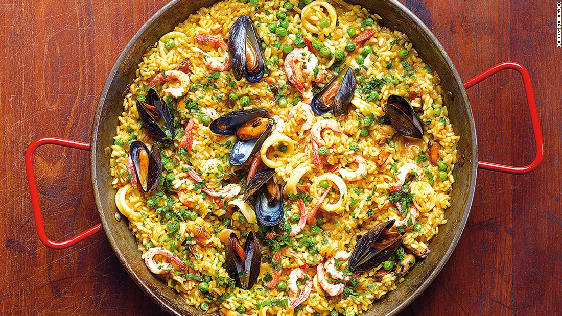 "Originating in the region around Valencia, paella traditionally comes in two varieties: paella Valenciana (with rabbit and chicken) and seafood paella. (Image credit: ""Quick & Easy Spanish Recipes"" by Simone and Inés Ortega, Phaidon, <a href=""http://phaidon.com"" target=""_blank"">phaidon.com</a>)"