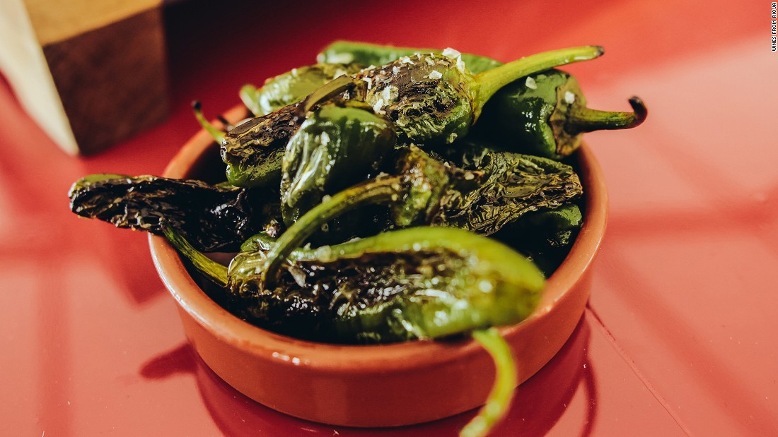 A perfect complement to a glass of rioja, these salted Padron peppers are addictively sweet, salty and sometimes fiery hot.