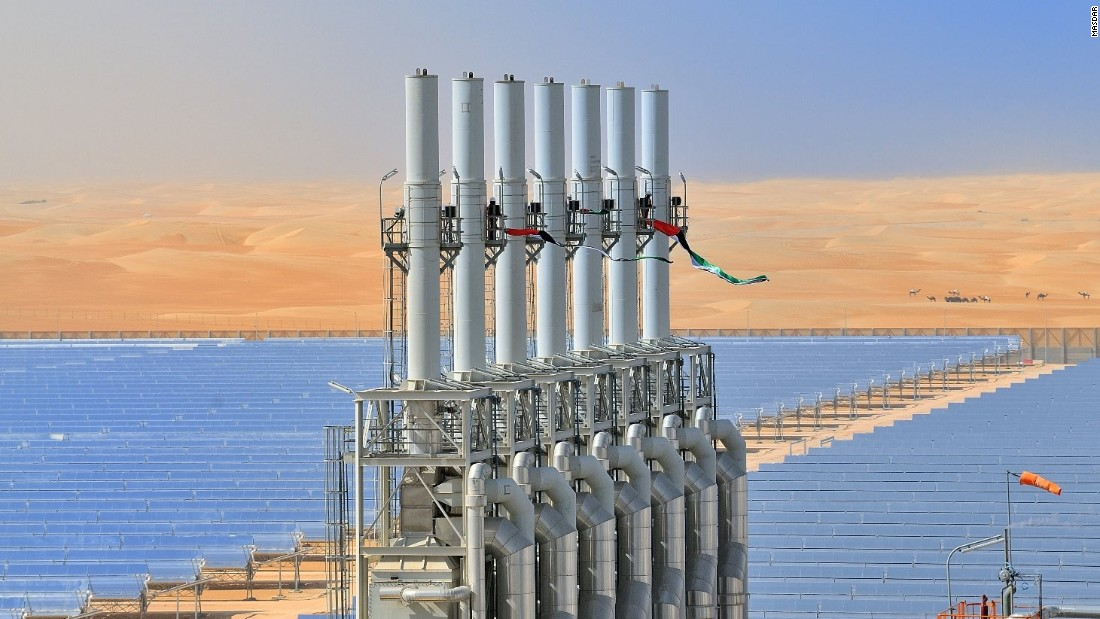 Perhaps the most ambitious project is SHAMS 1, a stand-alone 2.5km², 100MW Concentrated Solar Power plant. This plant was built about 100km from Masdar, at an estimated cost of US$600m. It is one of the largest of its type in the world, and displaces 175,000 tonnes of CO₂ annually -- equivalent to the emissions of 29,000 UK homes.