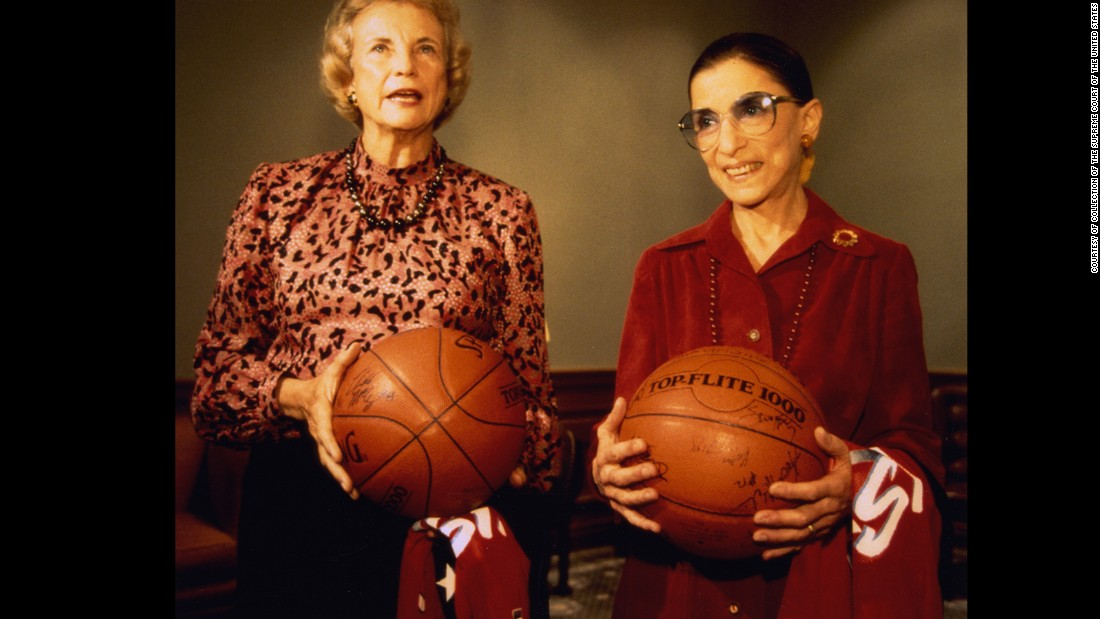 Justices Sandra Day O'Connor and Ruth Bader Ginsburg held basketballs that they received as gifts from the United States women's Olympic basketball team during the team's visit to the court on December 6, 1995.