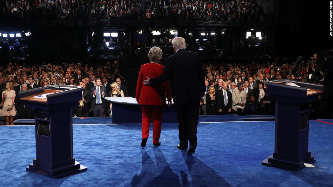 "Democratic nominee Hillary Clinton and Republican nominee Donald Trump pose for photos at the end of the <a href=""http://www.cnn.com/2016/09/26/politics/gallery/first-presidential-debate/index.html"" target=""_blank"">first presidential debate,</a> which took place in Hempstead, New York, on Monday, September 26. It was <a href=""http://money.cnn.com/2016/09/27/media/debate-ratings-record-viewership/index.html"" target=""_blank"">the most-watched debate</a> in American history. <a href=""http://www.cnn.com/2016/09/27/opinions/hillary-clinton-donald-trump-debate-opinion-roundup/index.html"" target=""_blank"">Who won? Analysts chime in</a>"