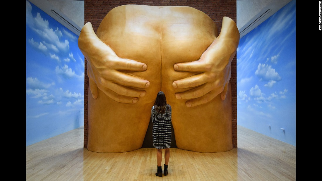 "A staff member at the Tate Britain art museum poses next to Anthea Hamilton's ""Project for a Door"" during a press preview in London on Monday, September 26. <a href=""http://www.cnn.com/2016/09/28/arts/turner-prize-2016/index.html"" target=""_blank"">A deeper look into the art world's most controversial award: The Turner Prize</a>"