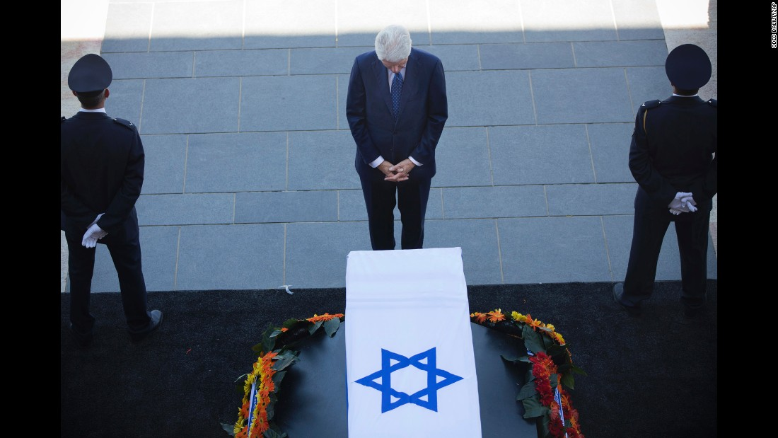 "Former U.S. President Bill Clinton pays his respects to former Israeli President Shimon Peres at the Knesset plaza in Jerusalem on Thursday, September 29. Peres, who shared a Nobel Prize for forging a peace deal between Israelis and Palestinians, <a href=""http://www.cnn.com/2016/09/27/middleeast/shimon-peres-obit/"" target=""_blank"">died Wednesday</a> at the age of 93."
