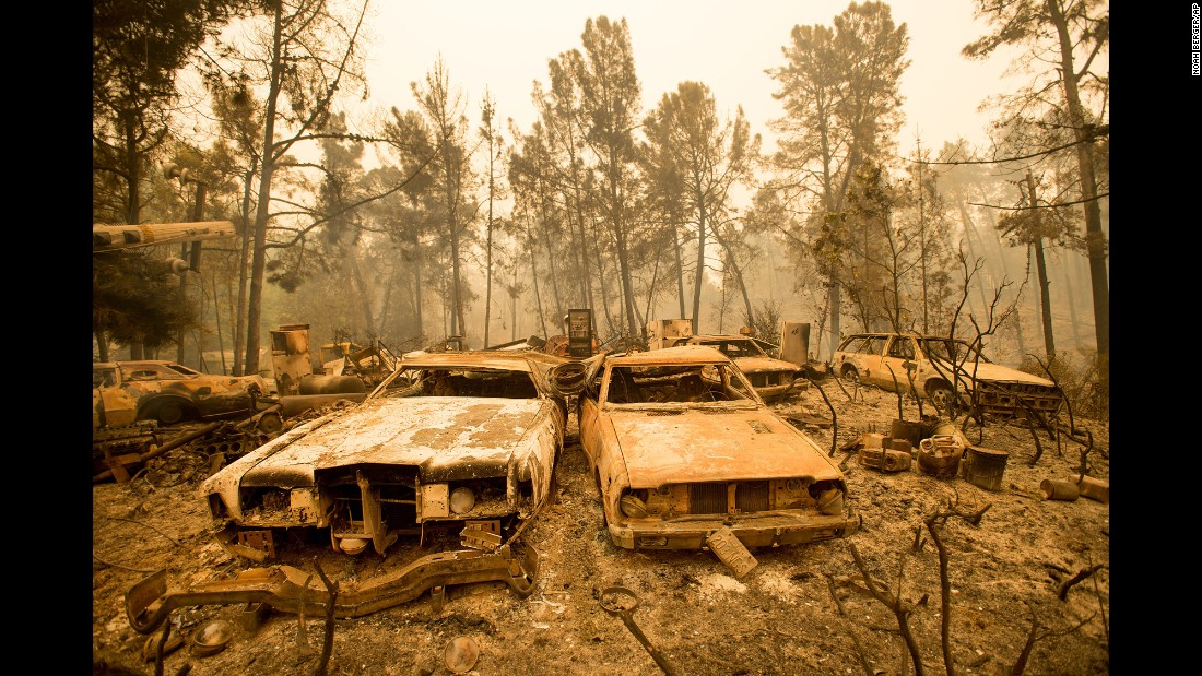 Vintage cars line a property near Morgan Hill, California, after the Loma wildfire burned through the area on Wednesday, September 28.