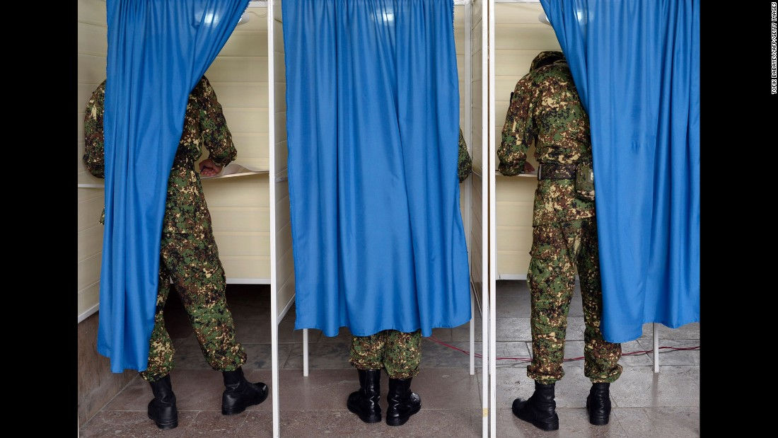 Azerbaijani soldiers vote at a polling station in Baku on Monday, September 26. A referendum was being held on whether to hand extra powers to long-serving President Ilham Aliyev.