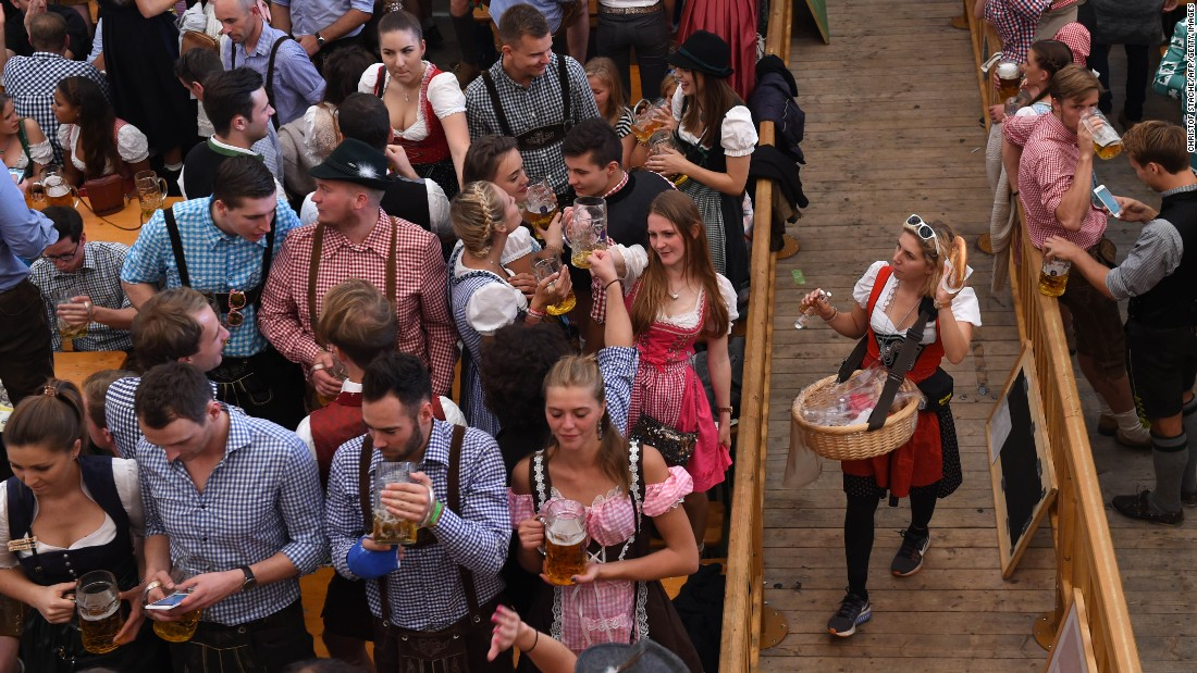 "People drink in Munich, Germany, during Oktoberfest celebrations on Wednesday, September 28. <a href=""http://www.cnn.com/2016/09/21/world/gallery/tbt-oktoberfest/index.html"" target=""_blank"">See lighthearted moments from Oktoberfest, the world's largest beer festival</a>"
