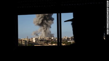 Smoke rises after a September 28 airstrike on Sirte, the last stronghold of ISIS in the north African country