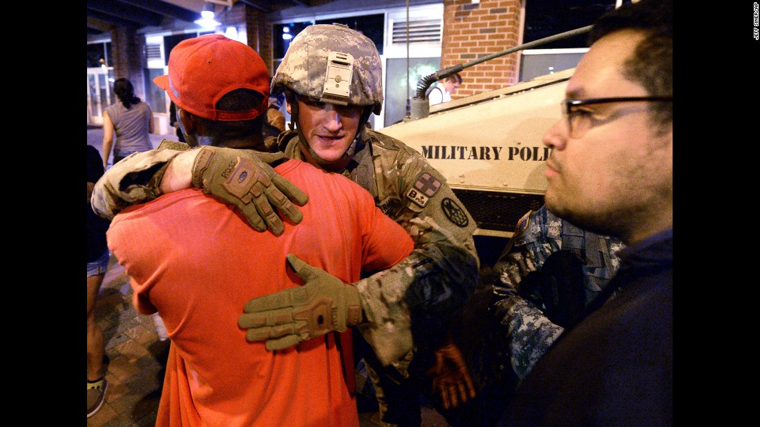 "A protester embraces a member of the National Guard in Charlotte, North Carolina, on Thursday, September 22. <a href=""http://www.cnn.com/2016/09/21/us/gallery/charlotte-protest/index.html"" target=""_blank"">Violent protests erupted in Charlotte</a> following the death of Keith Lamont Scott, who was shot by police in an apartment complex parking lot. Charlotte-Mecklenburg Police Chief Kerr Putney said Scott exited his car with a gun and that he was shot after he wouldn't drop it. Scott's family said he was unarmed and sitting in his car reading a book. <a href=""http://www.cnn.com/2016/09/27/us/keith-scott-shooting-one-week-later/index.html"" target=""_blank"">What we know a week later</a>"