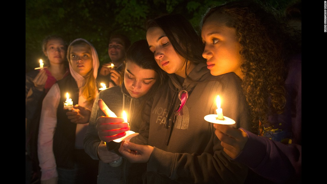 "Teenagers participate in a candlelight vigil in Burlington, Washington, on Monday, September 26 -- two days after <a href=""http://www.cnn.com/2016/09/26/us/washington-mall-shooting/"" target=""_blank"">five people were fatally shot</a> at a Burlington mall. Police say Arcan Cetin, 20, has confessed to the killings. He faces five counts of murder."