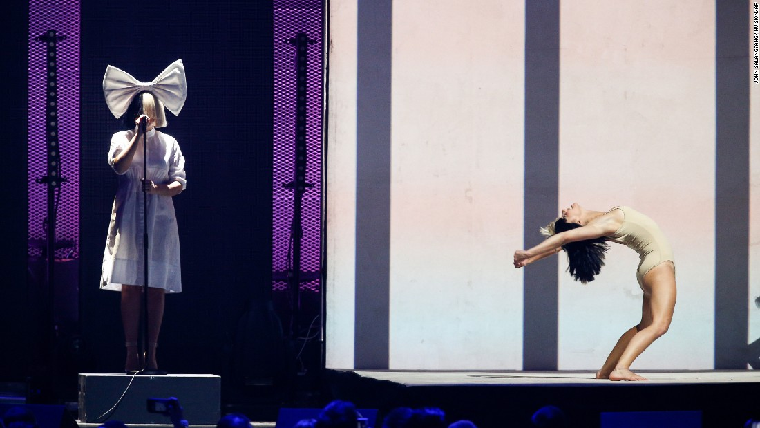 The singer Sia, left, performs in Las Vegas at the iHeartRadio Music Festival on Friday, September 23.
