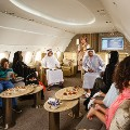 Flying palaces Emirates Executive Airbus ACJ319 Lounge with people 2