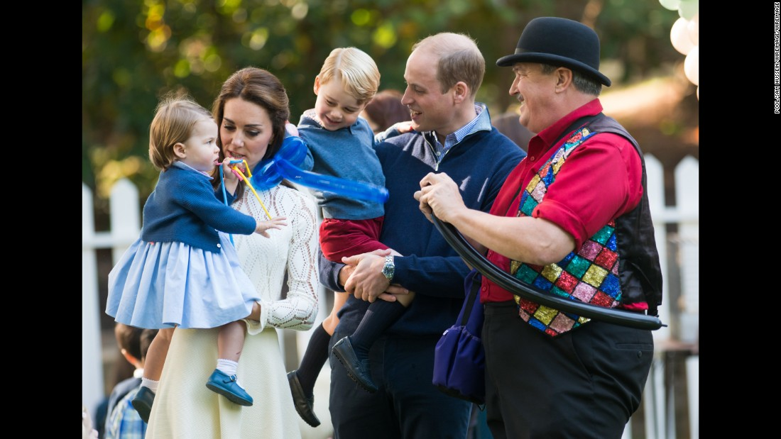 The royal family, including Catherine, Duchess of Cambridge, interacts with a balloon artist during the party on September 29.