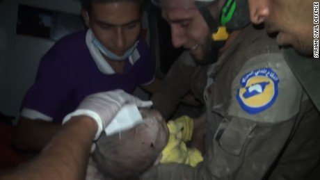The rescuer wept as this Syrian baby came back to life