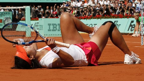 Li Na collapses in delight after winning the French Open in 2011.