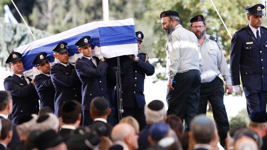 The flag-draped coffin arrives at Mount Herzl, where several eulogies were given by politicians and family.