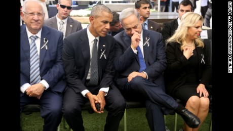 US President Barack Obama (C-L) talks with Israeli Prime Minister Benjamin Netanyahu (C-R) as they sit with Israeli President Reuven Rivlin (L) and Sara Netanyahu (R), the wife of the Israeli prime minister, at Jerusalem's Mount Herzl national cemetery during the funeral of former Israeli president Shimon Peres on September 30, 2016. / AFP / POOL / Menahem KAHANA        (Photo credit should read MENAHEM KAHANA/AFP/Getty Images)