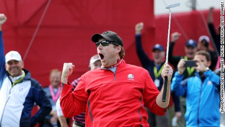 Fan David Johnson reacts after being pulled from the crowd and making a putt on the sixth green during practice prior to the 2016 Ryder Cup.