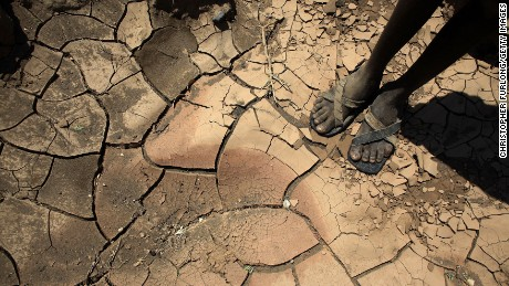 A young boy from the remote Turkana tribe in Northern Kenya stands on a dried up river bed on November 9, 2009 near Lodwar, Kenya.